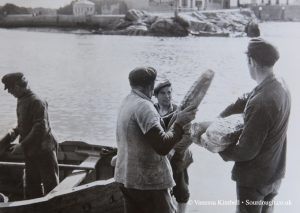1936 – French fishermen with bread – France