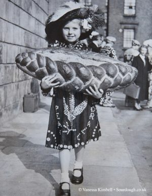 1951 – Girl with bread on the Old Kent Road - London