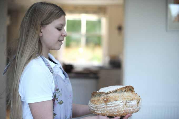 vanessa's daughter holding sourdough
