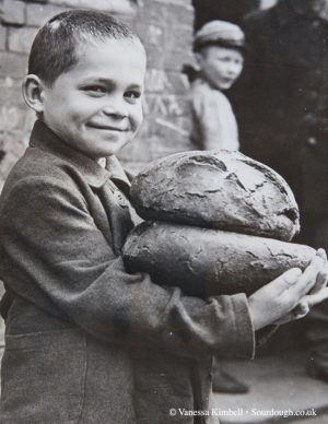 1946 – Boy with bread – Poland