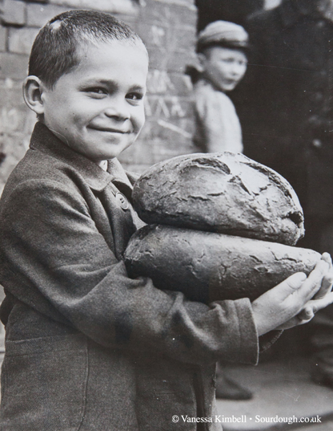1946 – Boy with bread – Poland