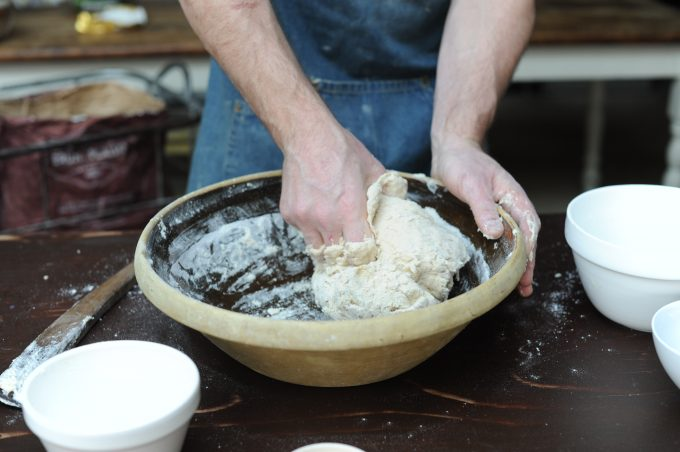 mixing sourdough ingredients